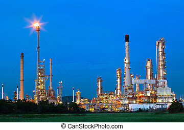 beautiful lighting of oil refinery palnt against dusky blue sky