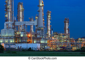 beautiful lighting of oil refinery palnt against dusky blue sky of oil refinery plant in heavy petrochemical industry estate