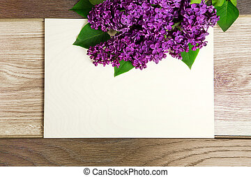 beautiful lilac flowers on wooden background