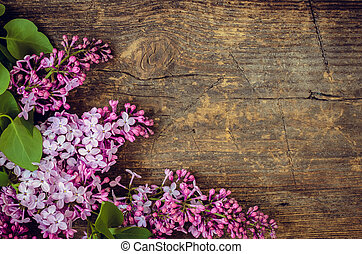 Beautiful lilac on a wooden background - Beautiful lilac...