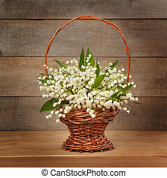 Beautiful lily of the valley in a basket