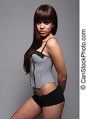 Beautiful lingerie girl in sexy corset underwear