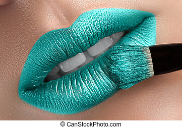 Beautiful lips with a brush.