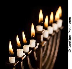 Beautiful lit hanukkah menorah on black. Super black...