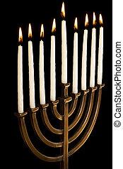 Beautiful lit hanukkah menorah on black background. -...