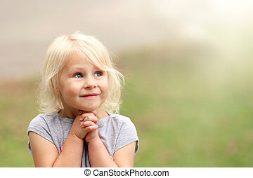 Beautiful Little 4 Year Old Girl Child Smiling Sweetly as She Prays