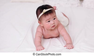 beautiful little baby girl Asian smiling