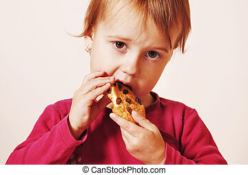 beautiful little baby girl eating Chocolate Chip Cookie