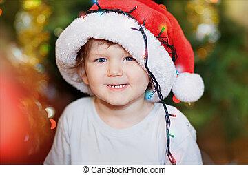 Beautiful little baby in Santa hat