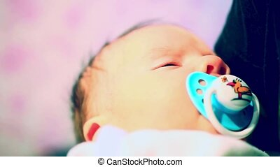 beautiful little baby slumber sleep with a pacifier in his...