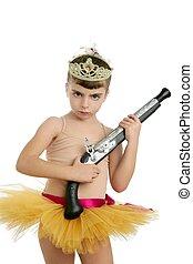 Beautiful little ballerina girl with blunderbuss