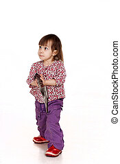 Beautiful little Caucasian girl posing with a fork
