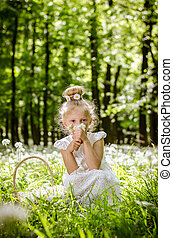 beautiful little child in spring forest