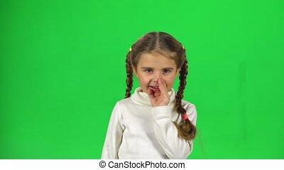 Beautiful little female is telling a secret. Greenscreen -...