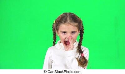 Beautiful little female is telling a secret. Greenscreen....