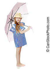 A stylish little girl with long blond hair in a very short, striped, summer blue dress and a straw hat. With a pink umbrella behind her shoulders. Isolated on white background.