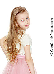 Beautiful little blonde girl with long hair. In a lush short pink skirt and white T-shirt. Turning his back to the camera. Isolated on white background.