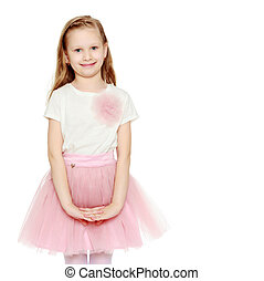 Beautiful little blonde girl with long hair. In a lush short pink skirt and white T-shirt. Isolated on white background.