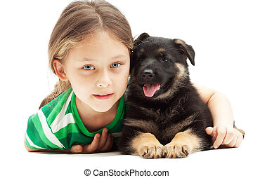 beautiful little girl and a German Shepherd puppy on white backg