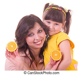 girl and her mother with orange
