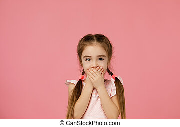 beautiful little girl asking to be quiet.