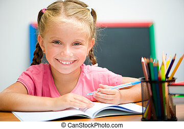 beautiful little girl at the desk