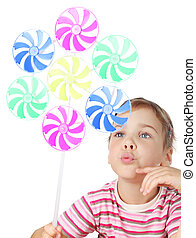 beautiful little girl blowing on big colorful toy windmill isolated on white