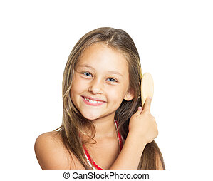 beautiful little girl combing her long hair comb on a white back