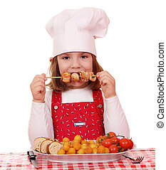 beautiful little girl cook eat grilled chicken meat