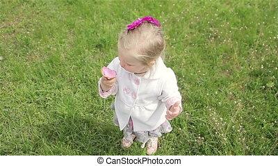Beautiful little girl eats ice-cream