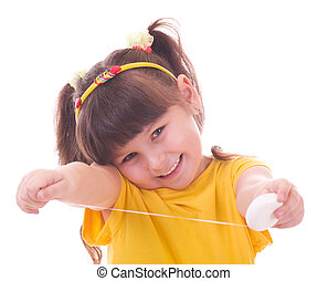 girl flossing her teeth - Beautiful little girl flossing her...