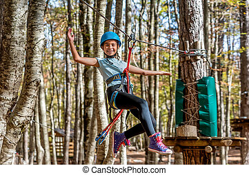 Beautiful little girl having fun in adventure Park, Montenegro