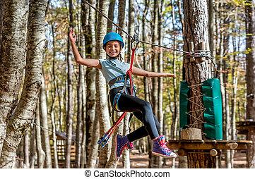 Beautiful little girl having fun in adventure Park, Montenegro