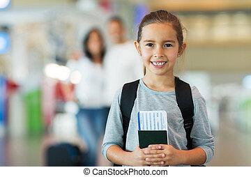 little girl holding passport and boarding pass - beautiful...