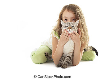 Beautiful little girl hugging her cat.