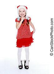 Beautiful little girl in a cap of Santa Claus