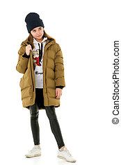 Beautiful little girl in a fashionable coat.