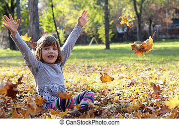 beautiful little girl in autumn park