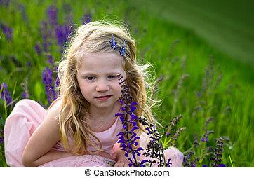 beautiful little girl in grass