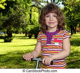 beautiful little girl in park portrait