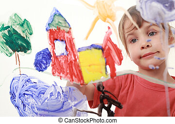 beautiful little girl in red t-shirt paints on glass, house, tree, man