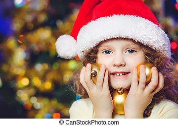 Beautiful little girl in Santa hat
