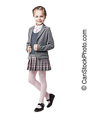 Beautiful little girl in school uniform isolated on white