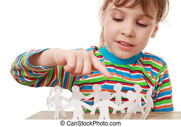 beautiful little girl in striped shirt play with garland of paper creatures