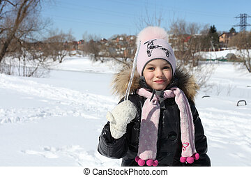 Beautiful little girl in winter park