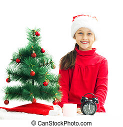 beautiful little girl is waiting the new year on a white backgro