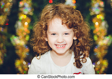 Beautiful little girl  looking at the camera and smileson the