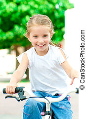 girl on a bicycle in the park