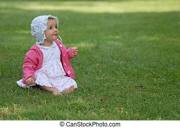 beautiful little girl on green grass
