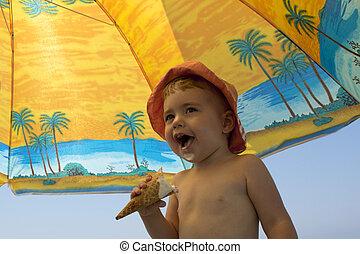 beautiful little girl on nature eating ice cream